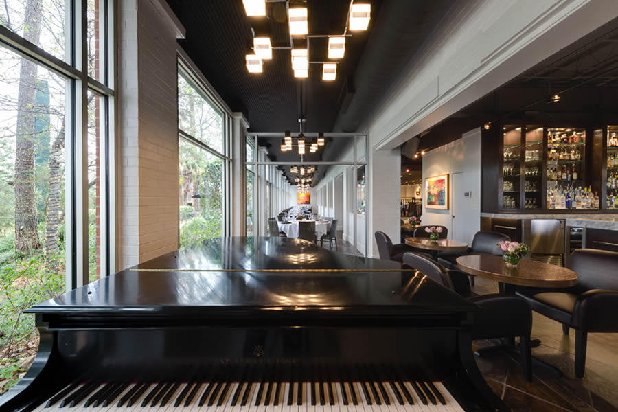 Image of the Amerigo's Grille Atrium and part of the Piano Bar from the point of view of the piano.