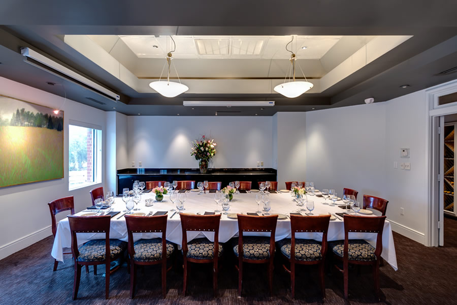 Image of the Amerigo's Grille Boardroom set for a private dining event.
