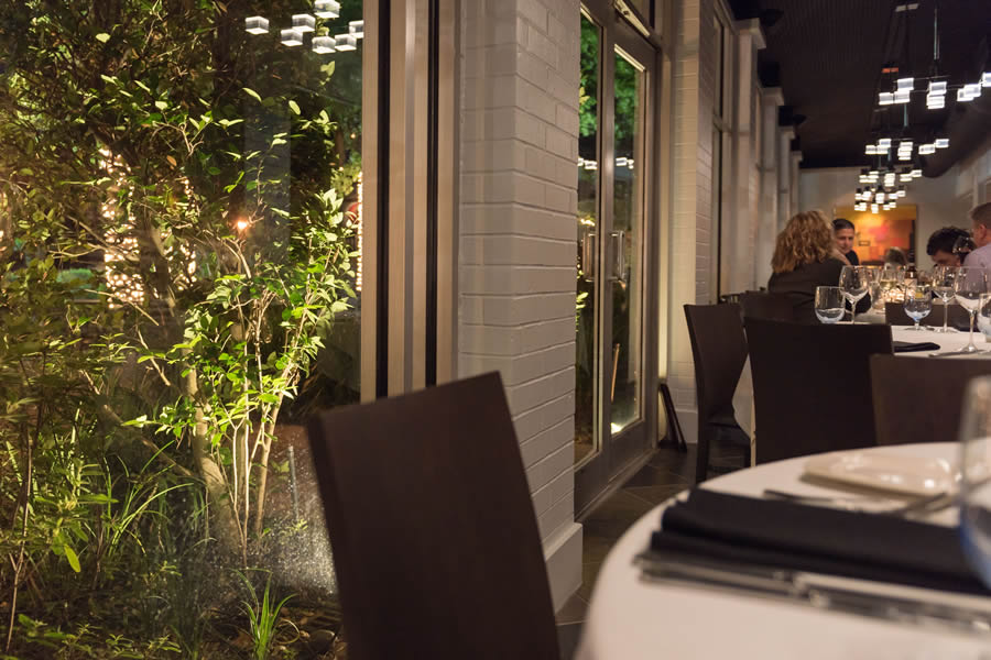 Image of the Amerigo's Grille Patio through the windows of the Atrium.