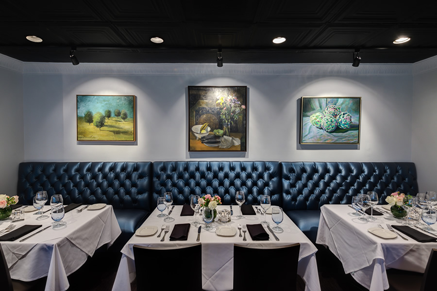 Image of the Amerigo's Grille Terrazzo surrounded by walls lined with paintings.