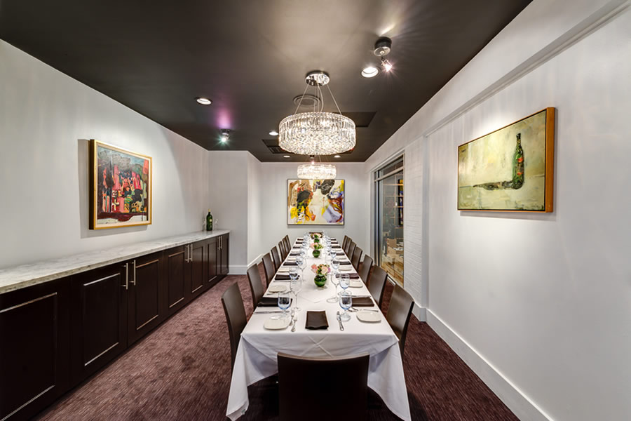 Image of the Amerigo's Grille Wine Room set for a private dining event.